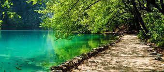 smooth path next to a calm lake