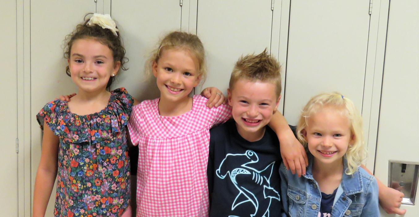 Four young TK students donated funds from a lemonade stand to help kids with negative lunch balances.