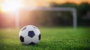 Sports equipment. Soccer ball on a field.