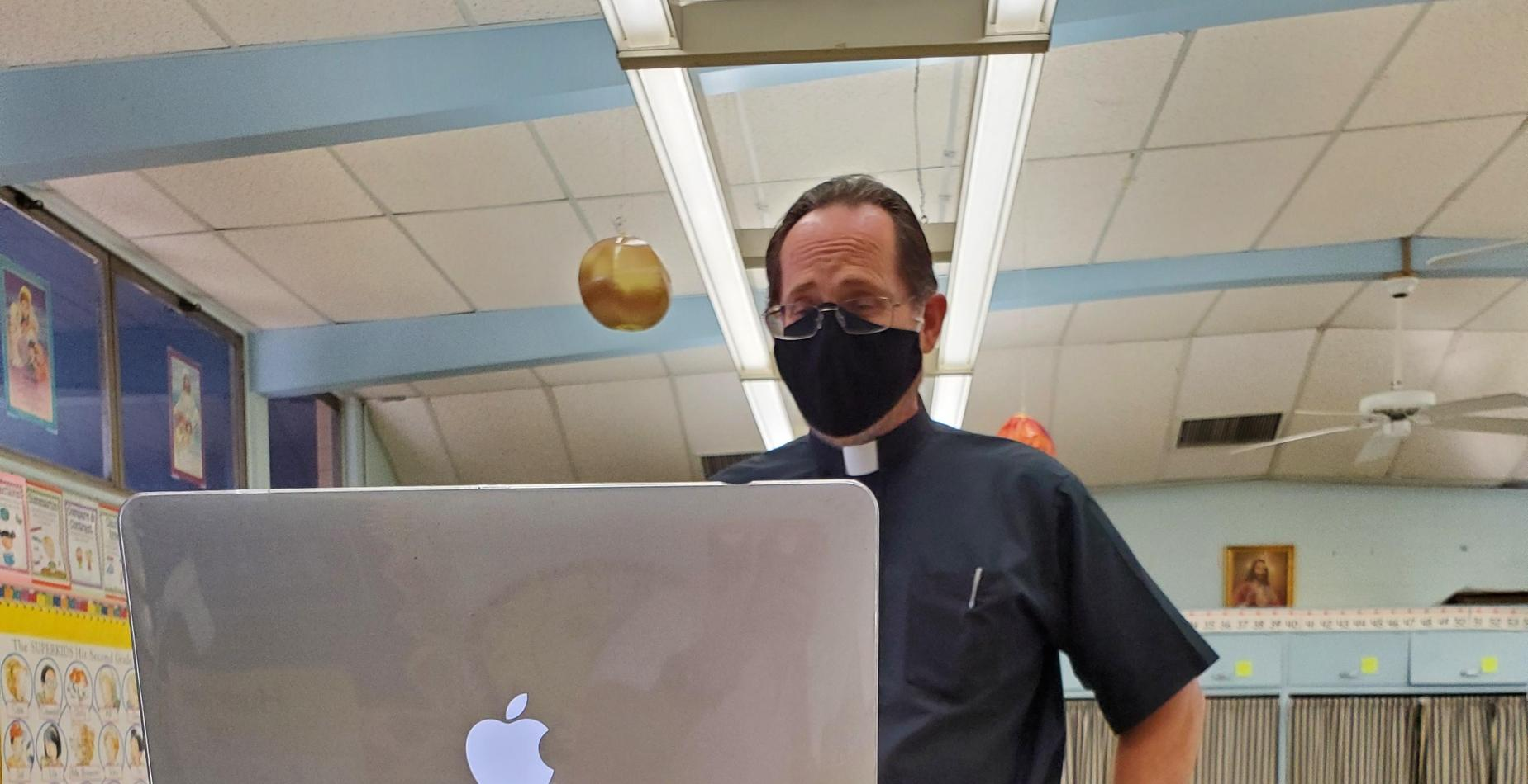 Father Ron teaching a class using virtual learning on Zoom