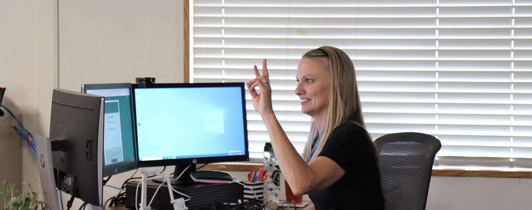 Teacher using sign language while teaching online