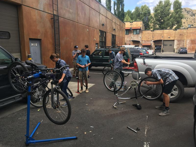 Students fixing bikes