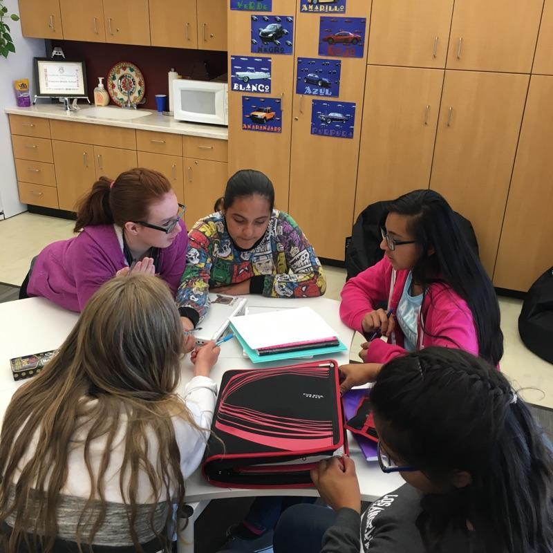 Students gathered around a table to study