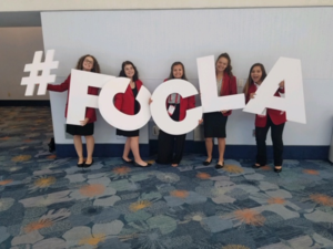 Kylee Miller, Gracie Studer, Alexus Hill, Jasmine Ondesko and Anastasia Jones pose with white #FCCLA cutouts.
