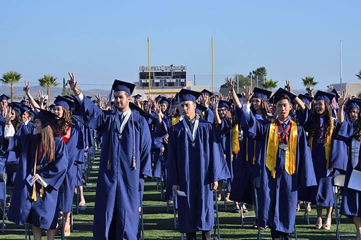 Students singing the alma mater at graduation