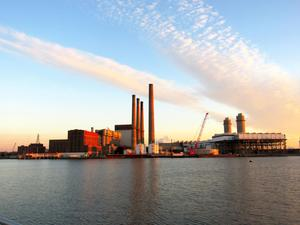 A distant photo of Exelon Generation's mystic power station at daybreak