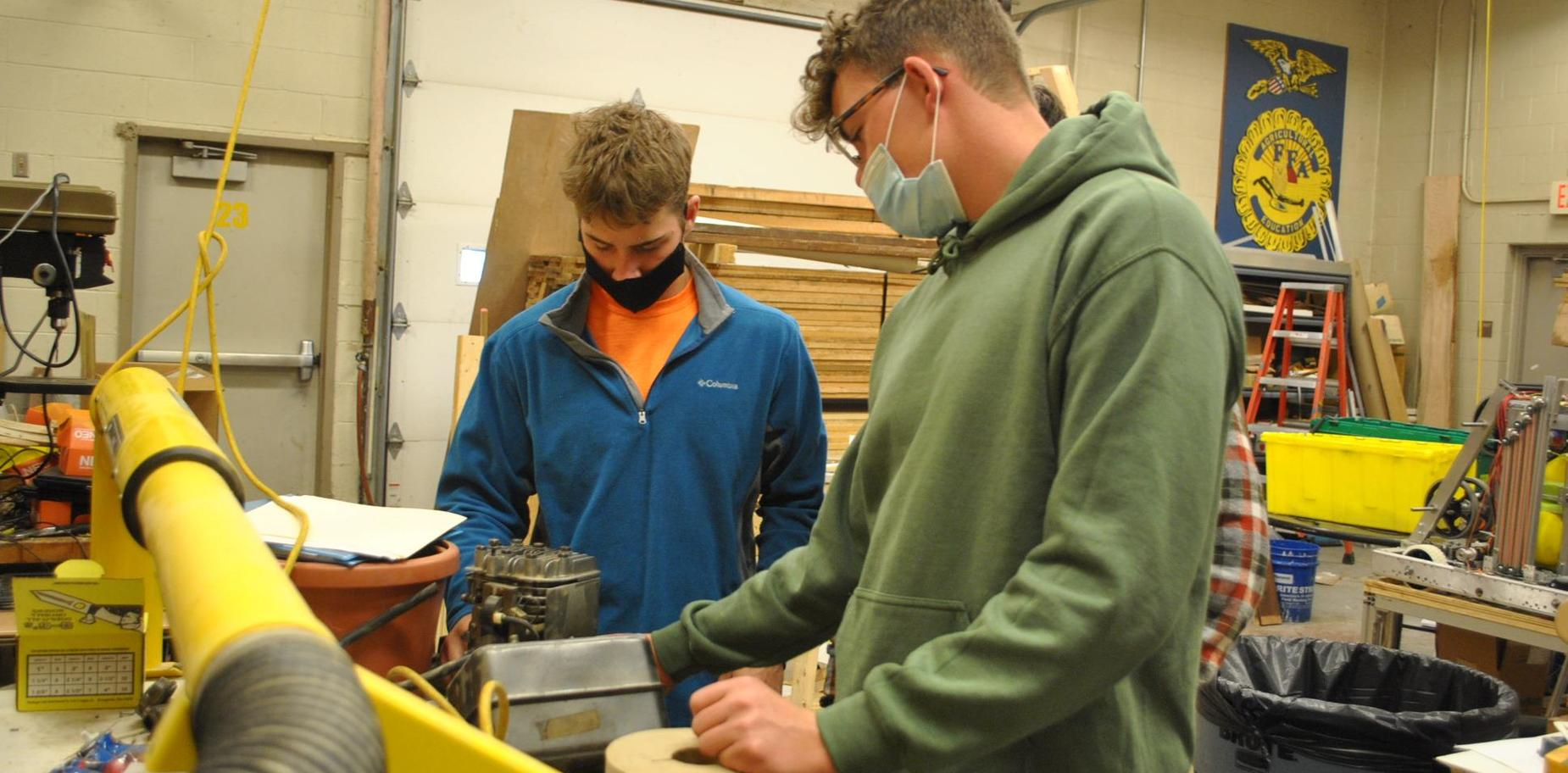 students working on a motor