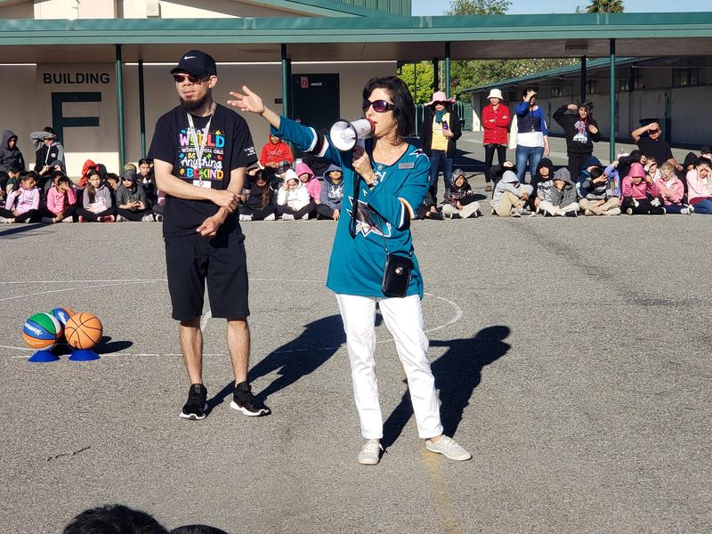 Principal Liz Herbstreith and Coach Adam Nacario open the Special Olympics Event