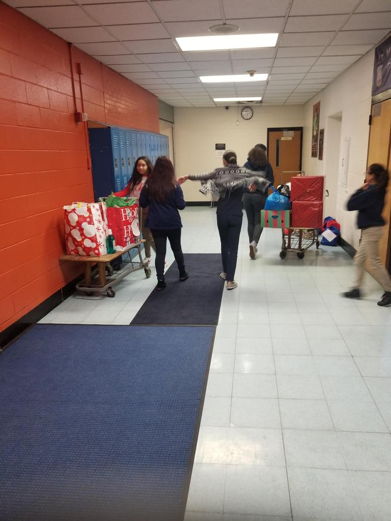 student council girls gathering the winter clothes in the basement hallway
