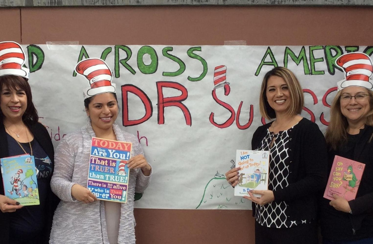 Office staff with Dr. Seuss books