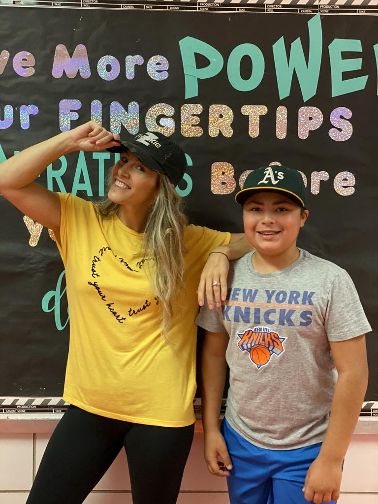 Mrs. Corio and student participating in Hat Day