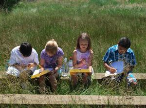 Students learning in their outdoor classroom