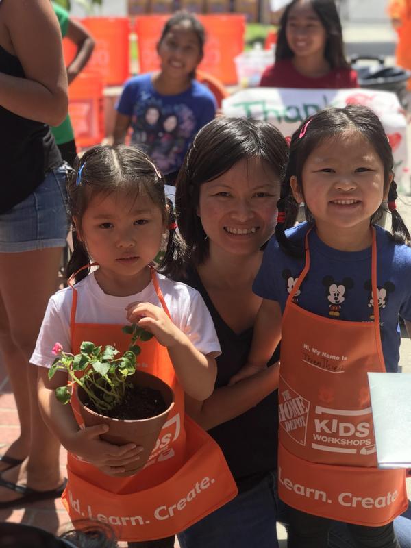 Families plant flowers