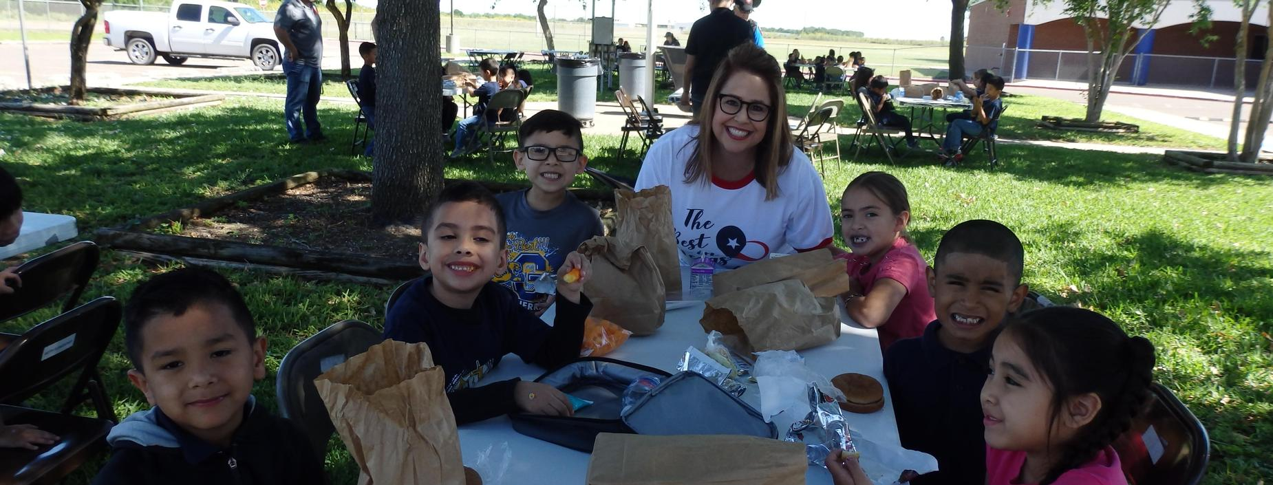 Image of students and Mrs. Valdez having a picnic.