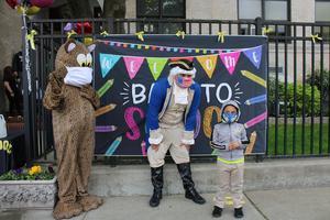 Jefferson impersonator and jaguar mascot greeting little boy