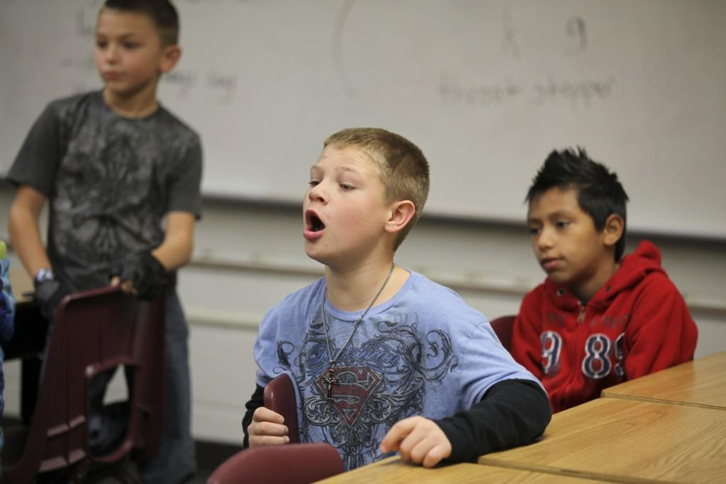 boy with mouth open in class