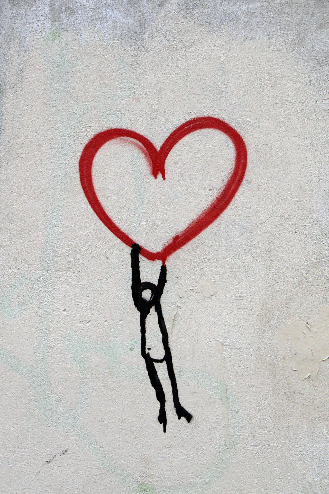 stick figure hanging from heart