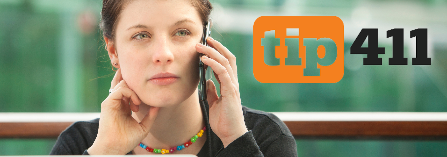 young woman on cell phone with tip 411 logo on top of the image