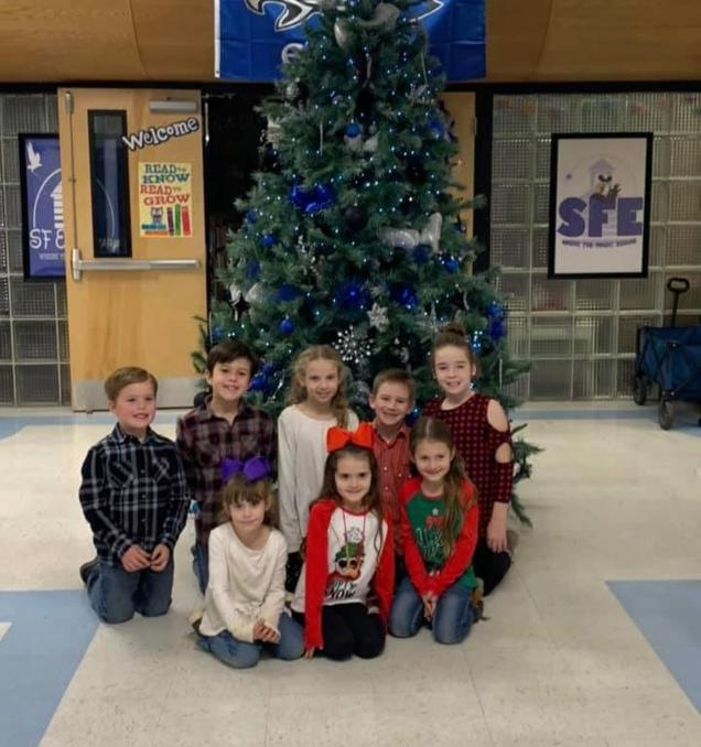 SFE students in front of Christmas Tree