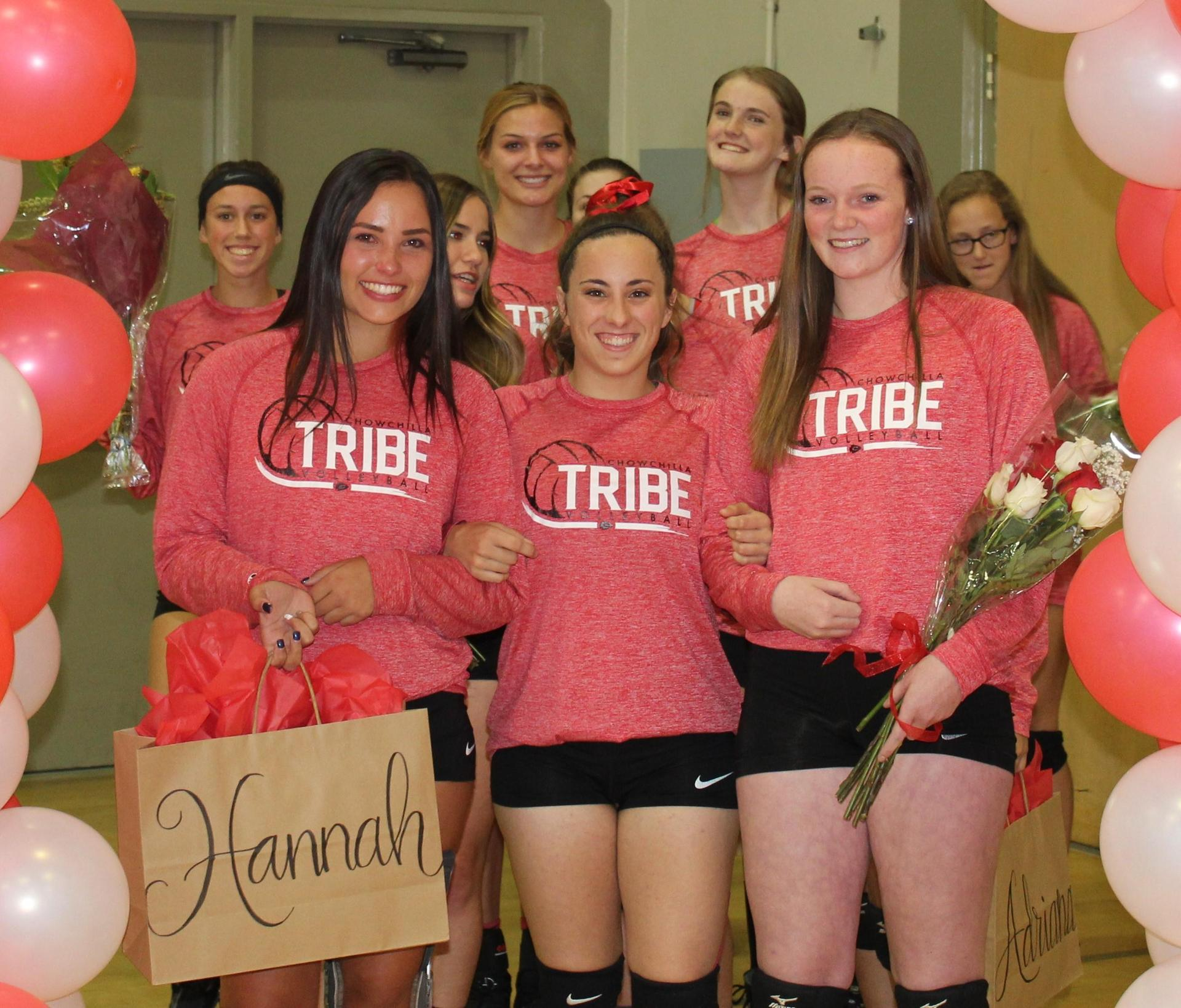 Sydney Alexander and Tori Calley escort Hannah Mancebo on Volleyball Senior Night.