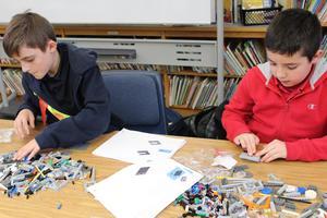 Boys building with Legos