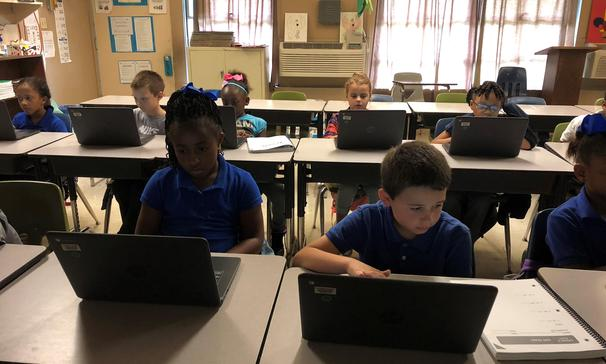 Ms. Robert's math class at Palmetto Elementary is hard at work on their Chromebooks!