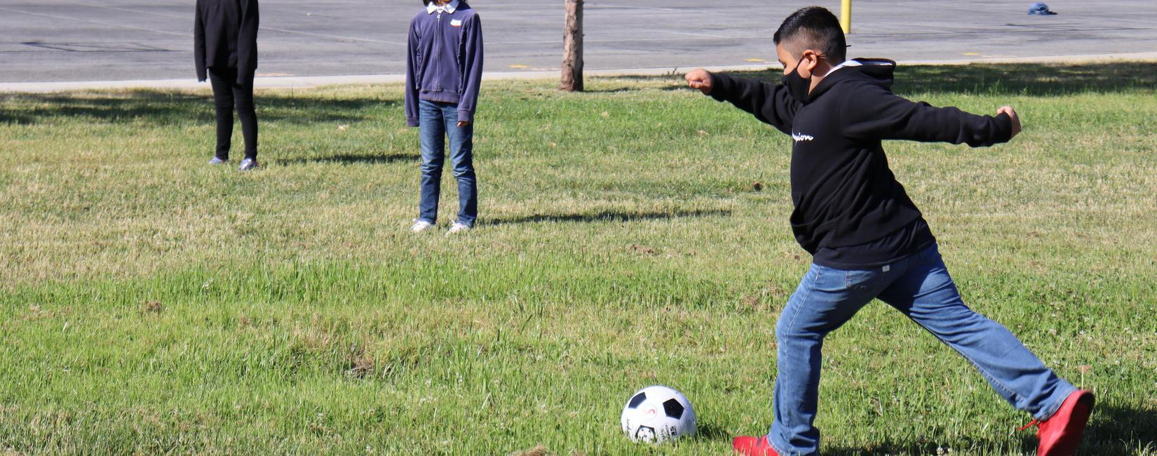 Photo: students playing soccer at recess