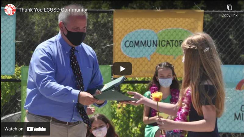 Video Thumbnail: Principal Handing Certificate to Student