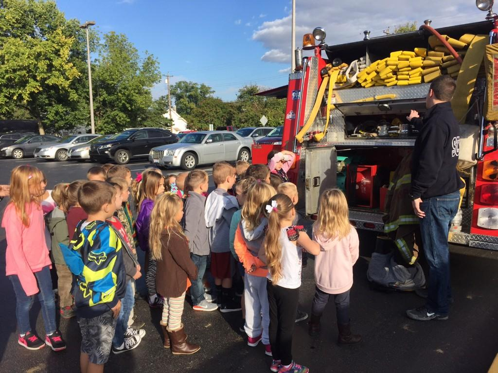 Students learning about the fire truck.
