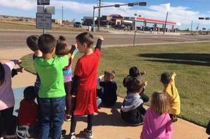 Students observing traffic light