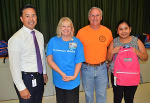 BPUSD_BACKPACK_1: Students from Baldwin Park Unified's Holland Middle School searched for their perfect backpacks on Aug. 13 during Kaiser Permanente's ninth annual Backpack and School Supply Donation Campaign. Pictured are, from left, Baldwin Park Unified Superintendent Dr. Froilan N. Mendoza, Kaiser Permanente Baldwin Park Medical Center's Chief Operating Officer Michelle Nowicki, Holland Middle School Principal Mike Rust and Holland sixth-grader Emily Campos.