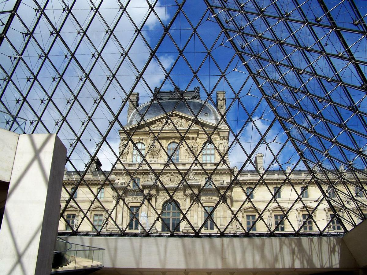 Photograph of the Louvre as seen through the pyramid, from PublicDomainPictures.net