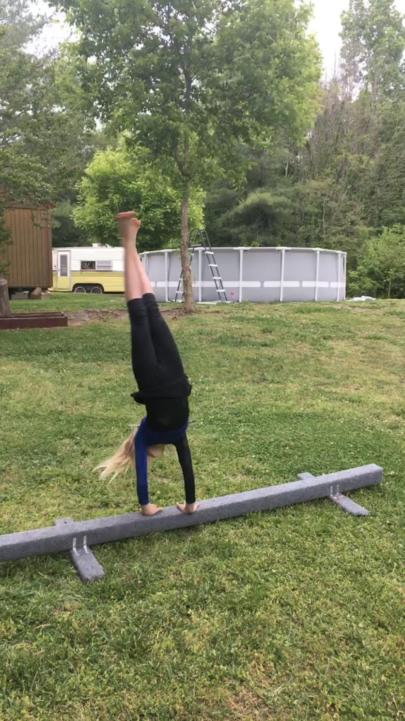 Kaylee perfecting some of her gymnastics moves on Workout Wednesday.