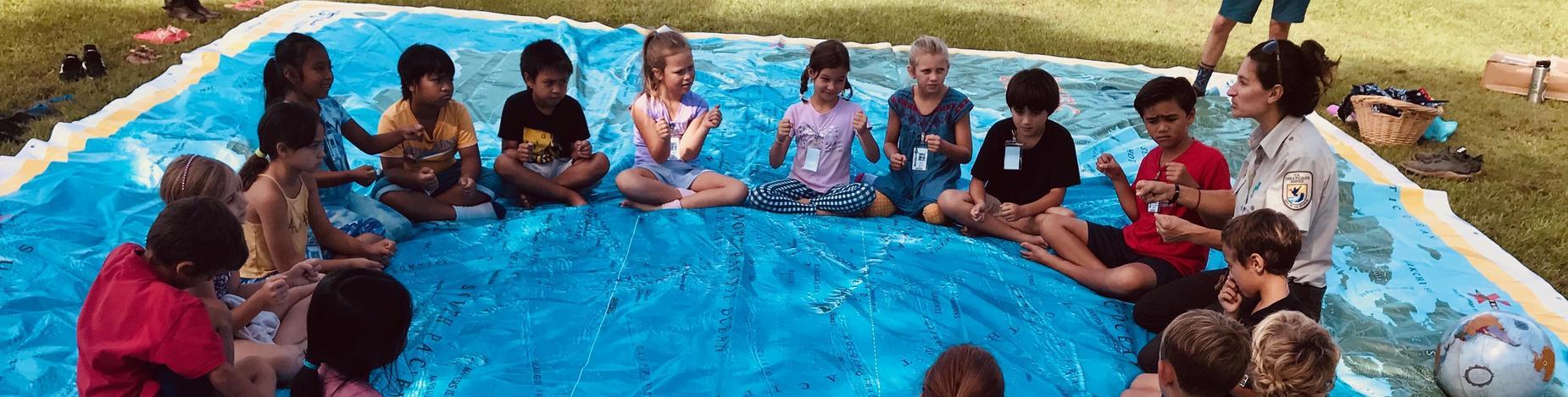 Kilauea Lighthouse Ranger teaches children about bird migration.