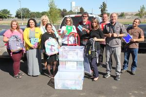 Pace International Employees delivering school supplies to elementary school principals