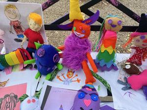 Plushies made by art students from Hill Country College Prep