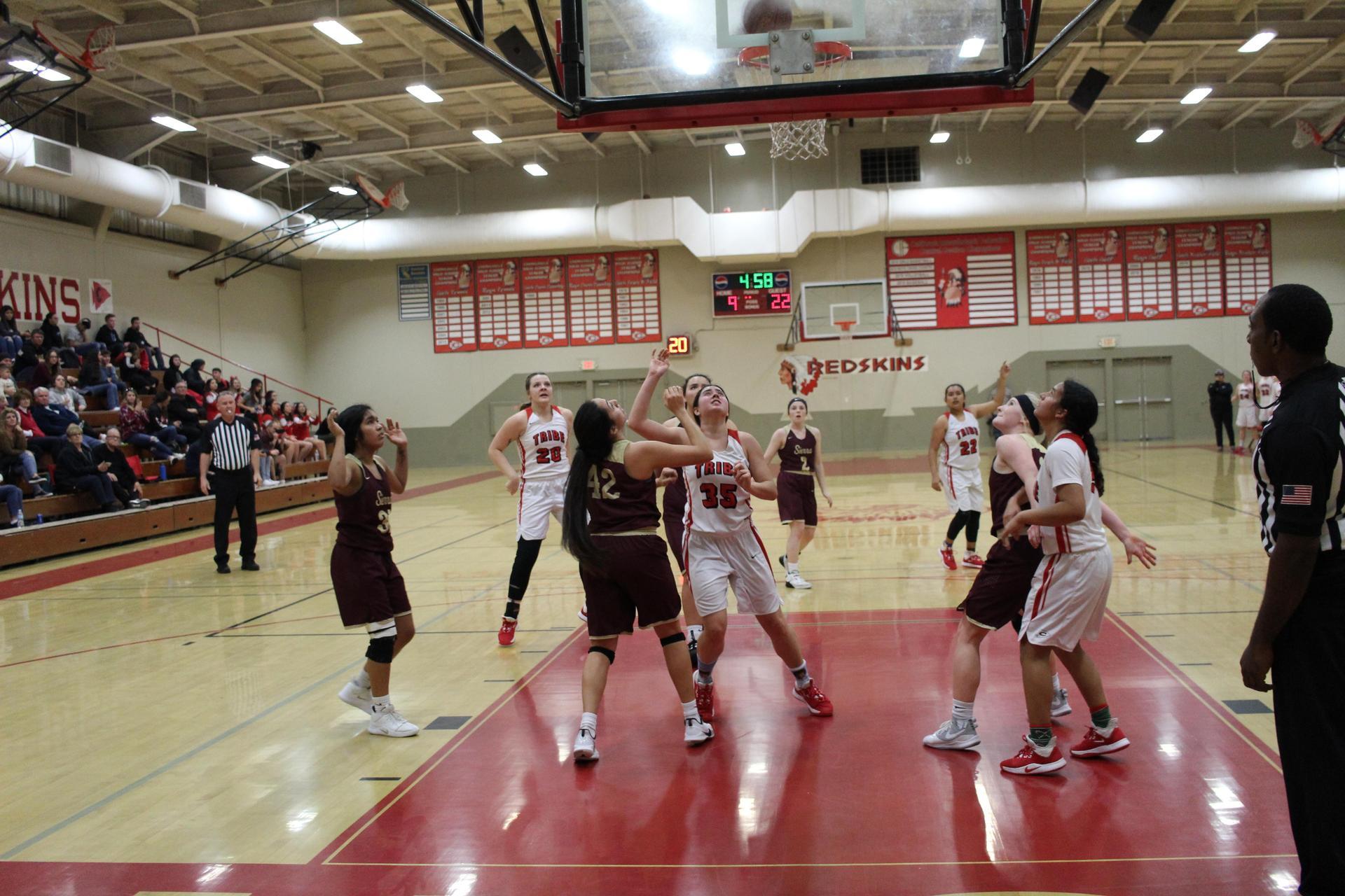 girls playing basketball