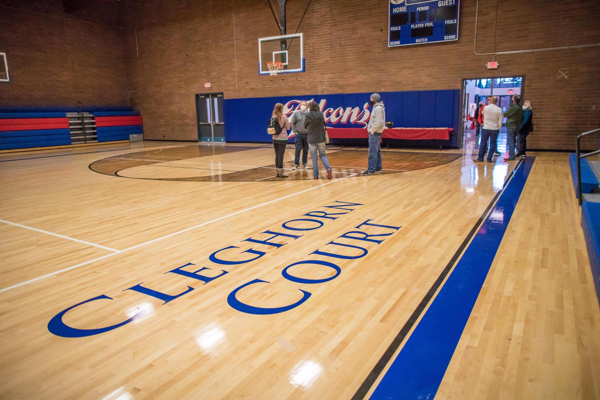 people gathered in the gym, titled the Cleghorn Court