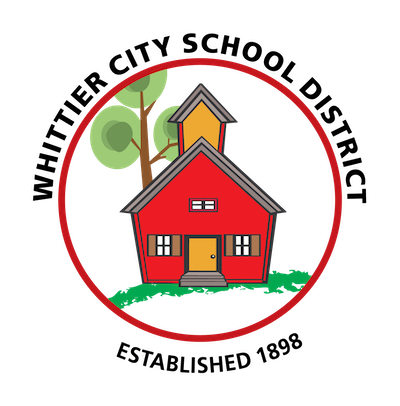 WCSD School District Logo , House is Red , and Tree in Background