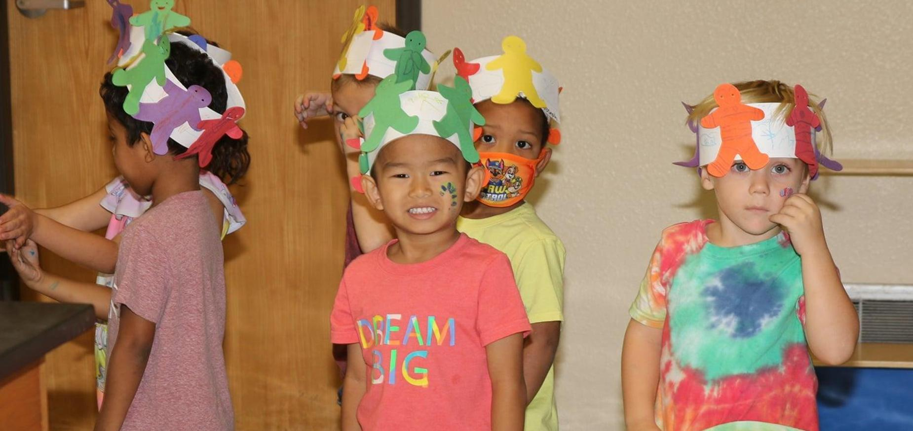 PreK student smiles for the camera on Candy Land Day