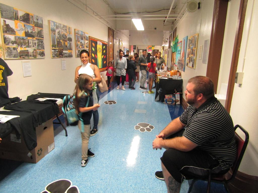 hallway of students parents and staff walking to classrooms