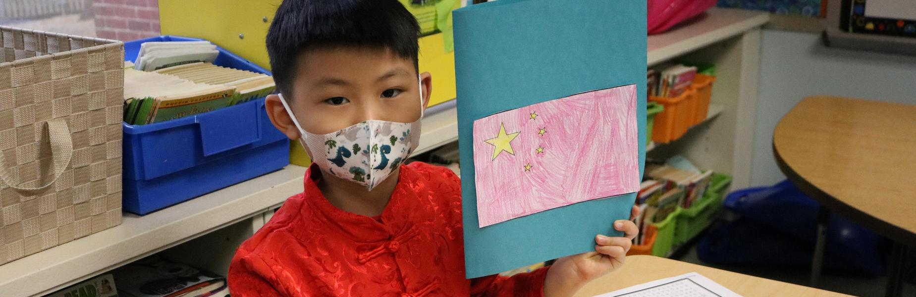 Photo of Franklin 2nd Grader participating in activities on China Day.