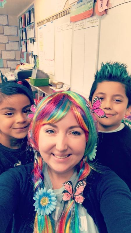 A teacher and two students showing off their crazy hair