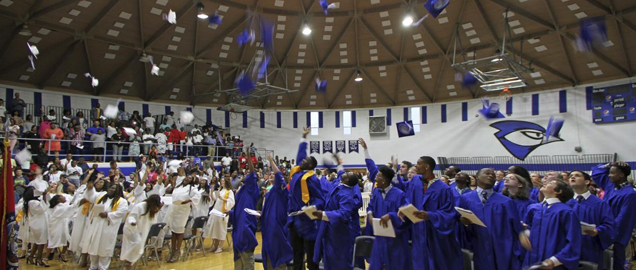 Graduates throwing caps in the air at CHS Graduation 2018