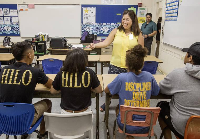 New Hilo-Waiakea Complex Area Superintendent Esther Kanehailua talks with student-athletes Monday on the first day of school at Hilo High School