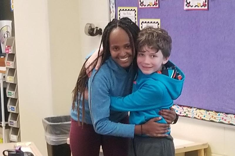 student hugs his sister