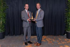Dr. Frank Donavan and Board President Nathan Zug receive Golden Bell Award