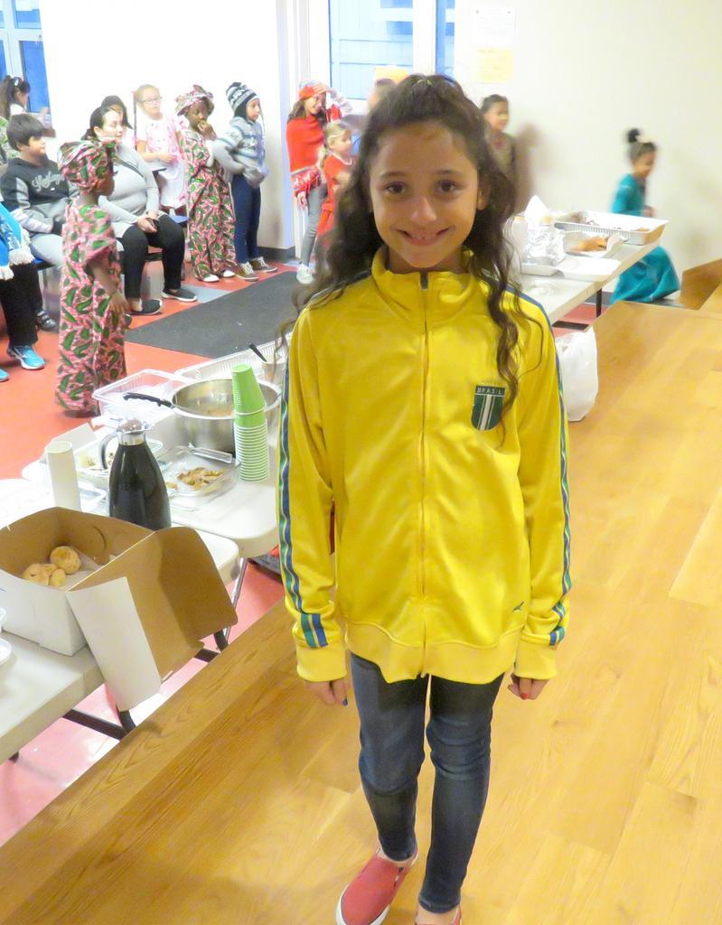 A student wearing a Brazilian soccer jacket