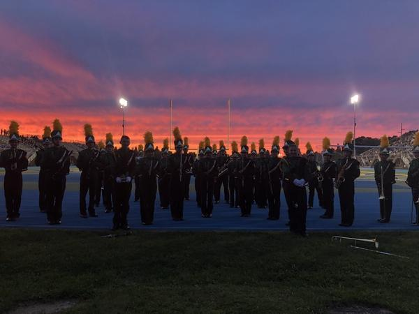 Marching Band practices at sunset
