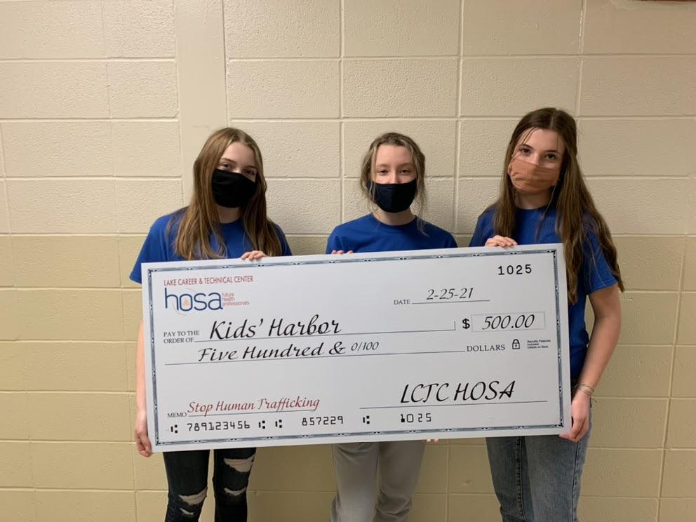 HOSA Kid's Harbor donation check